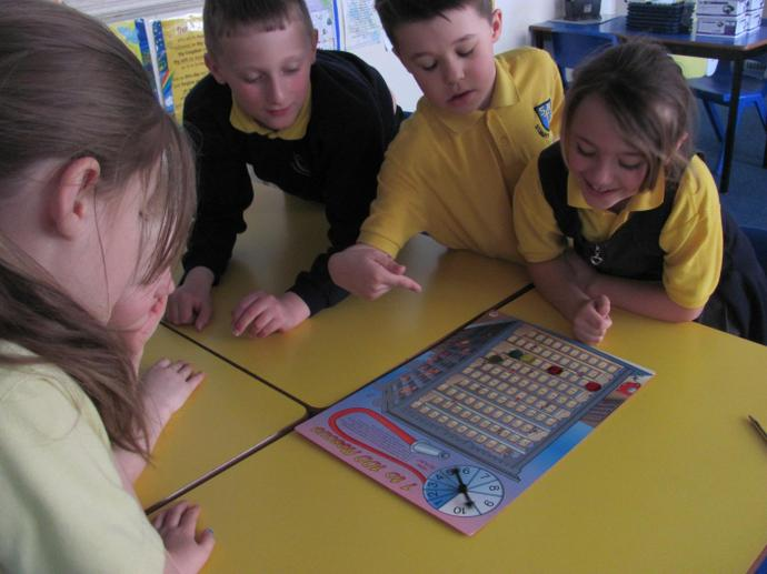 Playing maths board games together.