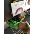 Painting his rainbow