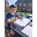 James enjoying painting in the sunshine