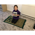 Rana Qur'an and prayer mat