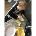 Learning hoe to make his own breakfast - well done