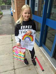 Our Rights Respecting Mascot designer collecting her prize!