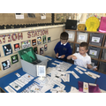 We used our Phonics to decode a caption and match it to the picture