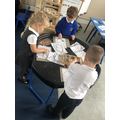 The children use our Loose Parts area to create pictures and patterns.
