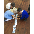 We practiced our Place Value skills by taking turns collecting numbers and ordering them
