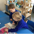 We developed our turn taking skills and fine motor skills to create a picture or pattern