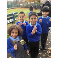 Year 1 investigating different types of leaves. They even made Autumn wreaths!