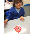 We used pointillism to create our poppies for Remembrance Day!