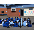We sat in the sun to complete our observational drawings of our school!