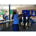 Year 2 completing a science experiment around how the body changes during exercise.