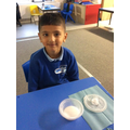 Year 1 completing a science experiment to see how long it takes ice to melt!