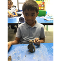 Making penguin clay sculptures inspired by Tanya Russell