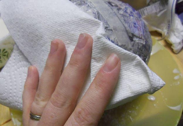 8. Blot excess liquid with a paper towel.