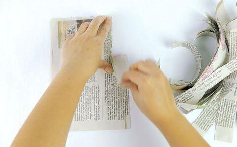2. Tear your newspaper into strips.