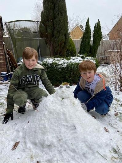 Harry and Kai with their snowman