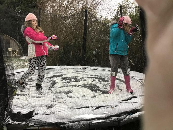 Savi and Amber bouncing in the Snow!