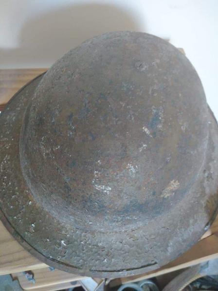 Tin hat worn by soldier.
