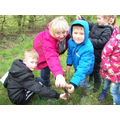 Our Year1's planting trees in our nature reserve