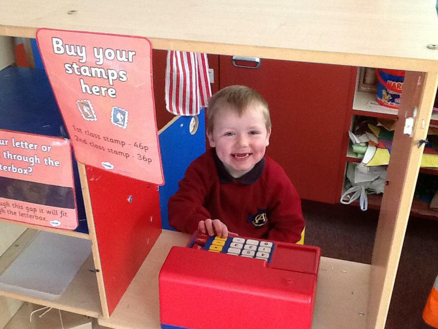 Alexander likes working behind the till too!