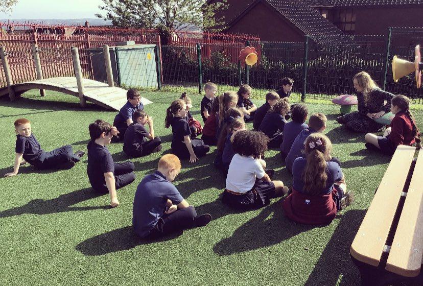Year 5 celebrating Roald Dahl week and enjoying their class novel in the sun