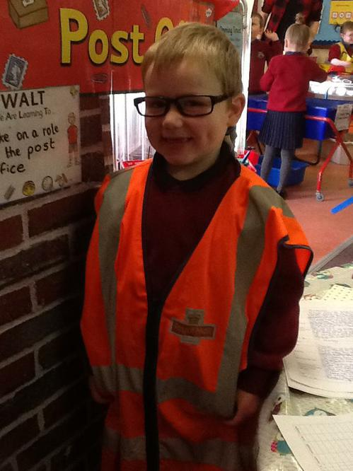 Alexander loves to dress up as the postman