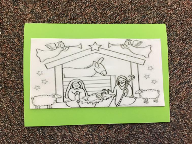 2. Draw or stick a picture of the nativity on the front.