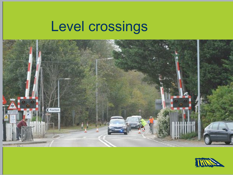 This is where a railway line crosses a road or path. Wait until the barriers are raised.