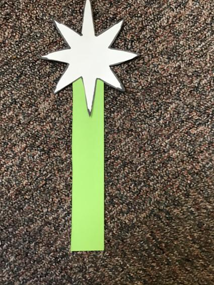 7. Stick your star to your strip of card/paper.