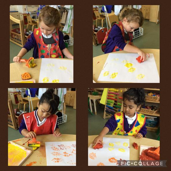 The children used rollers and leaf stamps to print using the colours of autumn.