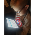 Tylor enjoying the Readtheory app!