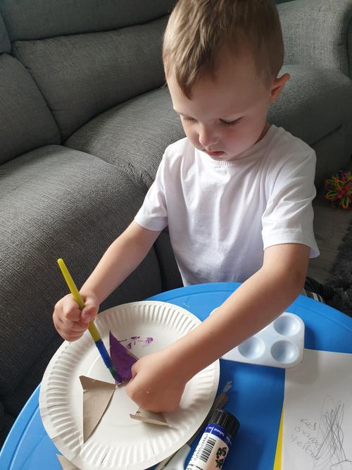 Painting his rocket!