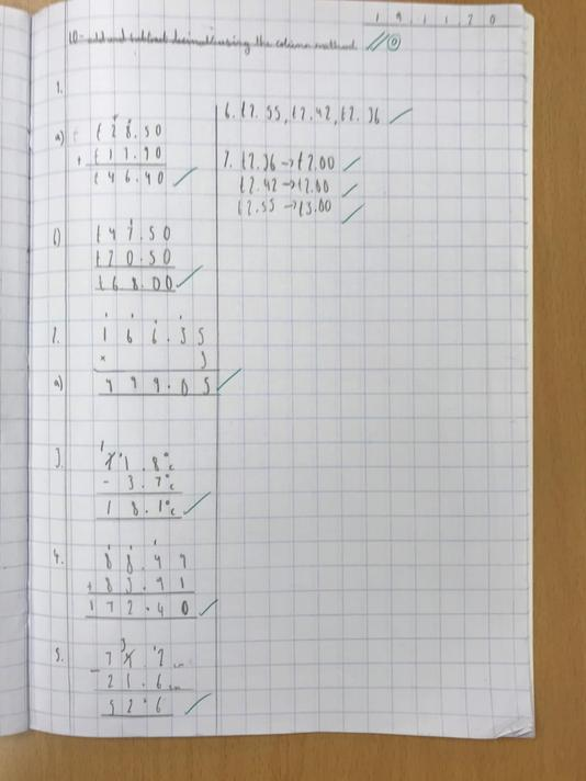 Grace's beautifully set out maths work showing using and applying skills.