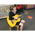 A child playing the G string with her eyes closed!