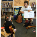 A child learning to play the songs 'Buzzing Bee' and 'Spanish Bee'