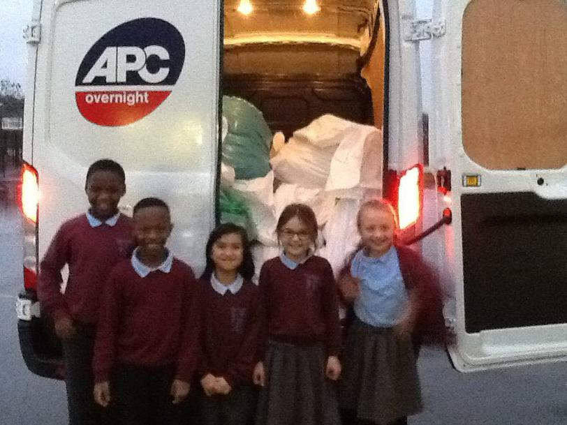 Helping load the Van for Mary's Meals.
