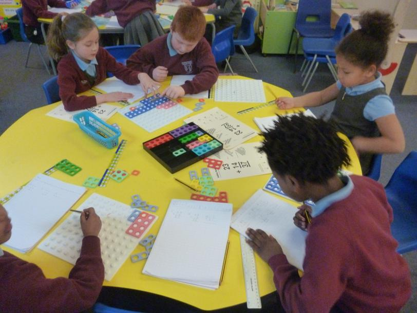 Using numicon to learn how to add 2 digit numbers.