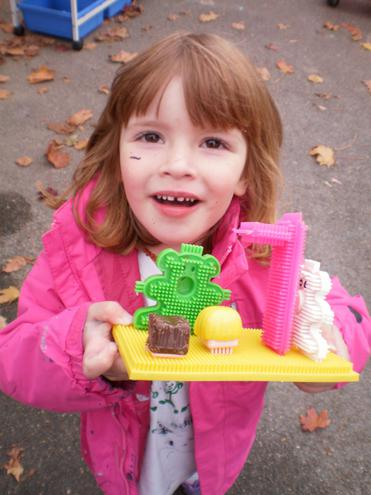 Making houses with sticklebricks.