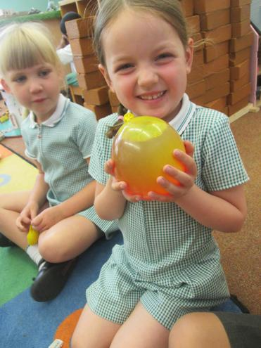 We filled balloons with water, food colouring
