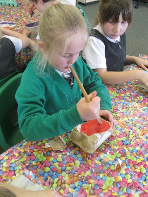 We painted egg box bodies.