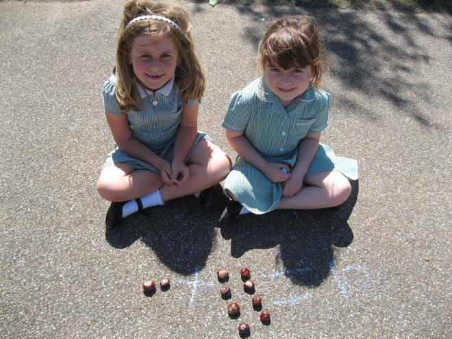 We used sticks, conkers and chalk