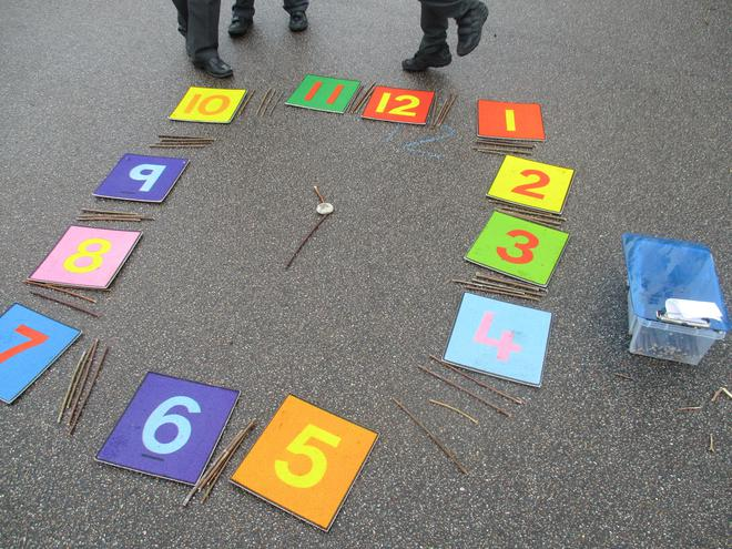 We made large clocks on the playground.