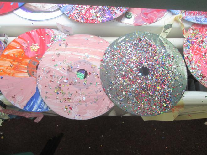 We decorated CDs with glitter