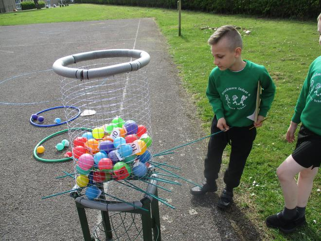 Giant outdoor Kerplunk!