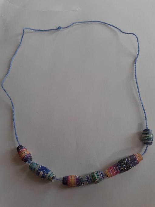 I made my beads using magazines and nail polish.