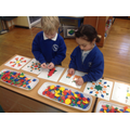 We are using 2D shapes to create Christmas themed pictures.