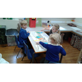 We tore small pieces of coloured paper and begun to stick them to create our names.