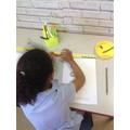 Measuring length using a cm ruler.