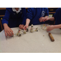 Using loose parts and playdough we made some snowmen.
