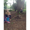 Children sang a songs around their pretend fire and cooked pretend food on sticks.