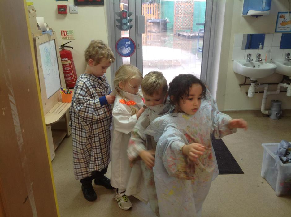 First the children helped each other put an apron on.